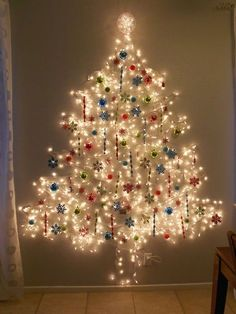 large lights tree with ornaments attached right on the light string