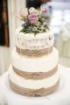 Burlap wedding cake with wood lovebirds topper / http://www.deerpearlflowers.com/rustic-country-burlap-wedding-cakes/2/