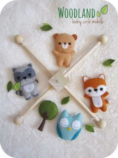 Made to order (current turnaround time is 7-8 business days). This crib mobile is a perfect decorative piece for your nursery or baby shower/new baby gift.  •INCLUDES• 1 Wooden frame 1 Fox plushie 1 Raccoon plushie 1 Bear plushie 1 Owl plushie 1 Tree plushie Small embelishments  Made with high quality eco-friendly felt. The design is originally made by me, Angeline. I hand-cut, hand-sew each item with lots of love.  Pet & smoke free home.  The wood hangers are also handcrafted with t...