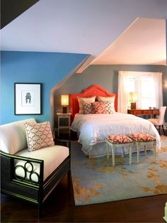 Here, orangey coral is an equally bright counterpoint to teal blue. A neutral, like black, paired with a color allows the color to shine without overwhelming the viewer.