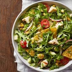 Peppery arugula, grilled corn and a tangy lime vinaigrette give this healthy taco salad recipe a serious upgrade.