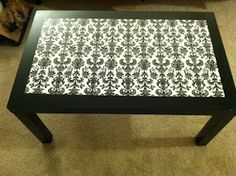Up cycle a coffee table with paint and wrapping paper