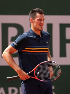 Bernard Tomic Photos - Bernard Tomic of Australia looks on during the mens singles firt round match against Marco Trungelliti of Argentina during day two of the 2018 French Open at Roland Garros on May 2018 in Paris, France. - 2018 French Open - Day Two French Open, Australian Open, Tennis Racket, Paris France, Two By Two, Men, Argentina, Roland Garros, Guys