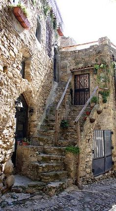 Bussana Vecchia ~ is a former ghost town in Liguria, Italy. Abandoned due to an earthquake in 1187 and repopulated in the by artists from all over the world. Places In Italy, Places To Go, Places Around The World, Around The Worlds, Stone Houses, Ancient Architecture, Turin, Abandoned Places, Stairways