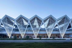 Image 1 of 40 from gallery of Qingdao Cruise Terminal / CCDI - Mozhao Studio & Jing Studio. Photograph by Zhang Chao, Xia Zhi Folding Architecture, Factory Architecture, Chinese Architecture, Facade Architecture, Amazing Architecture, Qingdao, Facade Design, Roof Design, Richard Rogers