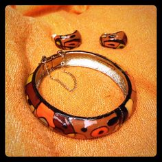 Vintage Eisenberg Artist Series Set Price Firm.  From the Artist series 1960s to 1970s. Beautiful Multi-Toned enamel, brown tones, burnt orange and black with locking chain clasp on bracelet. Clip earrings,comfortable to wear. Very unique set. Bracelet alone valued over $125.  As a set, valued well over $175. Minor chipping on bracelet around edges. eisenberg Jewelry Bracelets