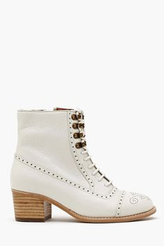 a girly combat/bootie type shoe? please.  Mattie Ankle Boot - Ivory  $218
