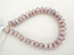 155CTS34BEADS NATURAL COATED PINK moonstone 10 11 mm faceted rondelle cp4