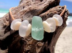 Hawaiian Gorgeous Aqua & Clear Beach Glass Separated by Authentic Hawaiian Puka Shells on Genuine India Leather Cord Bracelet by LindseysBeachGlass, $49.00