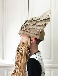 A fun DIY on how to make a cardboard viking helmet costume with wings.