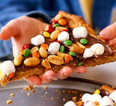 Peanut Butter Dessert Pizza -  For an after-school get-together, bake this cookie pizza and watch it disappear.