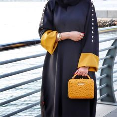 Navy blue and mustard abaya with embellished studds Iranian Women Fashion, Arab Fashion, Dubai Fashion, Muslim Fashion, Hijab Fashionista, African Fashion Dresses, Fashion Outfits, Fashion Shoot, Modern Abaya