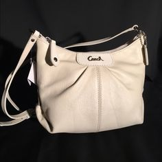 """NEW Coach Leather Ashley Crossbody Swingpack Beautiful cream crossbody or shoulder bag. Perfect for carrying all your essentials in style. Inside zip and multifunction pockets, zip top closure, fabric lining, adjustable strap for shoulder or crossbody wear. Strap drop: 18""""-21"""". Bag measurements: 8.25""""L x 7""""H x 3.25""""W.                                                           Sorry no trades Coach Bags Shoulder Bags"""