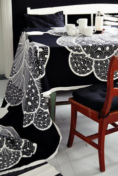 Black table cloth with large lace doily under place setting