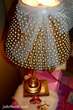 "A gold, beaded lamp! is it just me or does this lamp seem to say ""ILL-U-MIN-ATE! ILL-U-MIN-ATE!"""