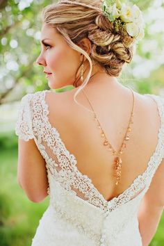 Your guests spend a good amount of time looking at your back, dress it up!: Elegant updo, open lace back gown with back necklace | photography by http://www.jaclyndavis.com/blog/    I also like the idea of attaching both ends of the necklace to the dress itself and letting it drape across that way.