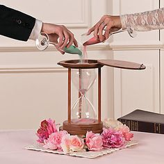 The joining of two lives is symbolized by a sand ceremony. A unity ceremony is a beautiful, touching part of your wedding day, and this hourglass will be an ...