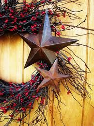 Metal stars on a twig and berry wreath. Simple and pretty. All year.