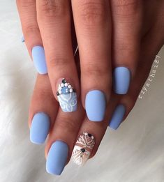 This beautiful sky blue nail polish with white patterns and beads is divine.