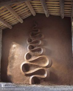 This design in clay is in a refuge near Digne-les-Bains in the South of France. It's such a special piece of work that to see it you need to reserve and collect the key to the refuge from the Gassendi Museum. It's by Andy Goldsworthy, a landscape artist that only uses natural materials. Click the picture for more including video or find other work with natural materials at www.naturalhomes.org/timeline.htm