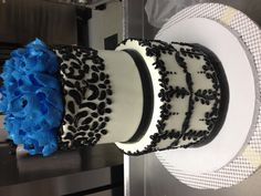 2 tier buttercream cake with filigree by The White Flower Cake Shoppe