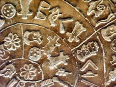 Phaistos Disc Detail - The written language of the Minoans is called Linear A by archeologists, linguists and historians, and has not yet been deciphered. The Mycenaean language, Linear B, was not deciphered until the 1950s, and linguists hope one day to crack the code, as more writings are unearthed in excavations.