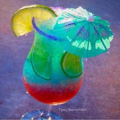 Rim with Lime juice and purple sugar. Fill with crushed ice, lime slices, and add- 1/2 oz. (15 ml) Raspberry Liqueur 1/2 oz (15 ml) Blue Rasberry Mix 1 oz. (30 ml) Malibu 1/2 oz. (15 ml) Blue Curacao Top off with Simply Limeade Lime Slice and Cocktail Umbrella garnish Instagram Photo Credit: @mystiquelyrogue Watch us make The The Sexy Monica Cocktail with Tipsy Girl Sophia!