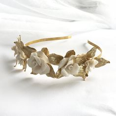 The Emelia Headpiece is a stunning crown of everlasting flowers. Each bloom is carefully handmade for the most stunning detail. This jewellery design is also available in with leaves in white enamel. White Enamel, Customized Gifts, Plating, Jewelry Design, Bloom, Brass, Detail, Flowers, Gold