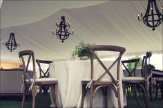 Goodwin Events - Crossback Chairs with our Restoration Hardware wine barrel chandeliers in a tent