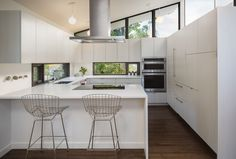 Without increasing the size of the kitchen, we reworked the space to create a family friendly design. This was accomplished by moving the range to the island, adding counter seating and increasing storage with full height cabinetry. Natural lighting in the kitchen was improved by adding low counter height windows.
