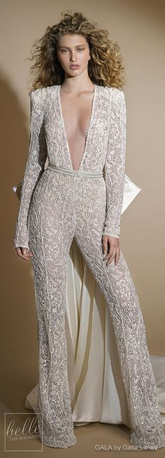 Wedding Dress by GALA by Galia Lahav Collection No. VI | long sleeves deep plunging v neck full embellishment glamorous jump suite bridal gown | modern sexy chic jumpsuit wedding gown keyhole back chapel train | #weddingdress #weddingdresses #bridalgown #bridal #bridalgowns #weddinggown #bridetobe #weddings #bride #weddinginspiration #weddingideas #bridalcollection #bridaldress #fashioninsta #jumpsuit #dress See more gorgeous bridal gowns by clicking on the photo