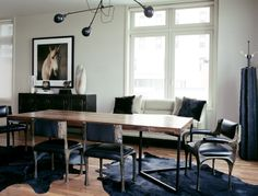 Paul Evans Brutalist chairs. OC White chandelier. Dining room table made out of railroad ties. And black cowhide rugs tie the room together. // www.blairgordondesign.com