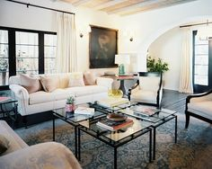 4 small square glass tables put together  Living Room Photo - A white sofa and pair of chairs with a grouping of four glass end tables