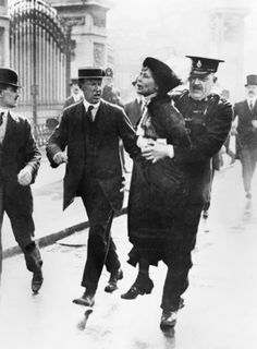 Mrs Emmeline Pankhurst, Leader of the Women's Suffragette movement, is arrested outside Buckingham Palace while trying to present a petition to King George V in May 1914.