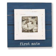 Painted wood frame features layered moulding and painted 'first mate' caption under photo opening.  3 1/2' square image slides in to frame on frame construction from front.  Hangs on wall or stands with dowel easel.