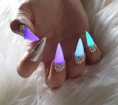 Glowing colorful rhinestone stiletto nails
