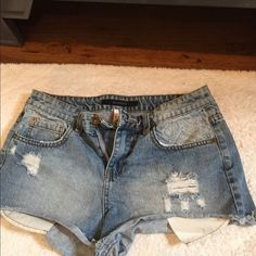 Billabong Jean shorts Light wash. Distressed. Size 26. White design on pockets in both and front. Pockets are showing Billabong Shorts Jean Shorts