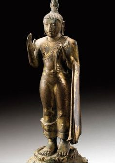 Rare Bronze Buddha figure of size 15 cm, 5 7/8  in from Polonnaurwa period. Sold at Sotheby's 08/12/08 for 15,000Eur.     10TH-11TH CENTURY
