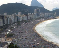 Once in a lifetime: Nuns mixed with bikini-clad young women as nearly the entire 2.5-mile crescent of Copacabana¿s broad beach in Rio overflowed with people to see the Pope.