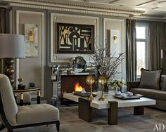 25 Ways to Paint a Room GrayFor a couple's apartment in a historic building on Chicago's Lake Shore Drive , designer Jean-Louis Deniot created interiors that merge European refinement with American vigor. Dark walls inset with beige panels and framed by white moldings bring a sense of drama to the living room. (December 2011).