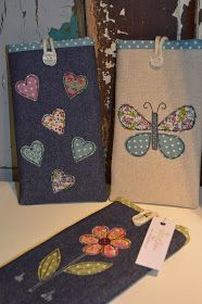 Handmade gadget, phone and glasses cases decorated with freehand machine embroidery designs.