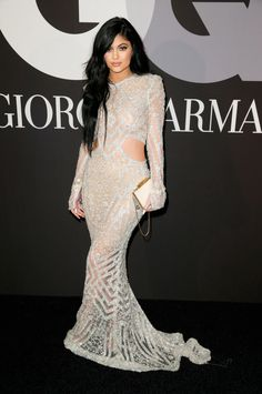 Kylie Jenner from 2015 Grammys After-Party Looks.The youngest of the Kardashian-Jenner clan wore a slim-fitting (and ultra-sheer) metallic gown with side cut-outs and bell-shaped sleeves. Kendall E Kylie Jenner, Kylie Jenner Style, Estilo Kylie Jenner, Kardashian Jenner, Kardashian Kollection, Long Sleeve White Gown, Giorgio Armani, Mode Glamour, Tyga