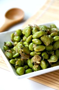 Edamame (soy beans) sautéed with garlic...yumm. Great superfood. Make sure to get organic, non-GMO!