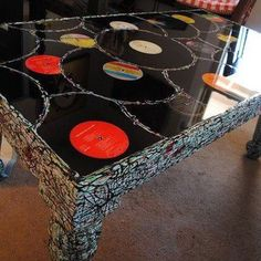 Coffee table made from old albums, then covered with polyurethane? Cool!