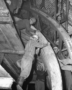 Black-and-white photograph men in protective clothing creating concrete formwork in the Tumut Pond Dam tunnel. Snowy Mountains Hydro-Electric Scheme, New South Wales, Collection: National Archives of Australia Snowy Mountains, Move Mountains, Concrete Formwork, National Archives, South Wales, Pond, Electric, Photograph, Military