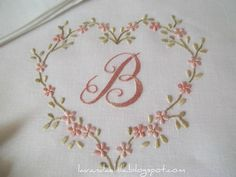 Expertly Embroidered Monogram encircled with delicate pink flowers and heart. Embroidery Hearts, Embroidery Letters, Embroidery Flowers Pattern, Hand Embroidery Designs, Ribbon Embroidery, Cross Stitch Embroidery, Machine Embroidery, How To Embroider Letters, Embroidered Pillowcases