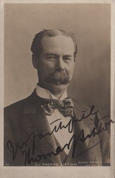 LIPTON THOMAS: (1848-1931) Scottish Merchant and Yachtsman, creator of the Lipton Tea brand. Vintage signed sepia postcard photograph of Lipton in half-length pose wearing a suit with a large bow tie. Photograph by Rotary Photo Co. Ltd, London. Signed ('Yours faithfully Thomas Lipton') in bold black fountain pen ink to the base of the image.