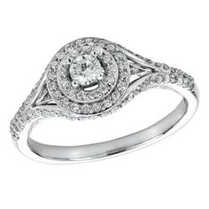 Rows upon rows of sparkling diamonds sit among the band and a perfect double halo around the extraordinary round Glacier Fire center stone. Crafted in 10k white gold the total diamond weight of this bridal ring is .50 carats. Glacier Fire is where Canada shines the brightest.