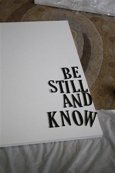 Quote on canvas using chipboard letters. Stick them on and paint over. I must get some chipboard letters!