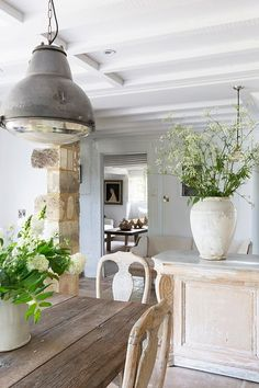 Don't take ones cue from a Low ceiling....reverse it with a large pot or one large piece of furniture.  Anton & K Antiques